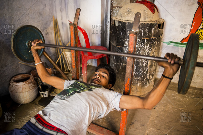 Varanasi, India - March 7, 2014: Kushti wrestler weightlifting, Varanasi, India