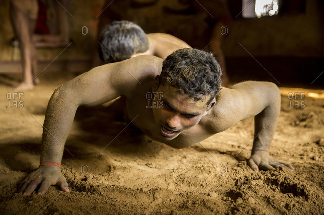 Varanasi, India - March 8, 2014: Kushti wrestlers fighting, Varanasi, India