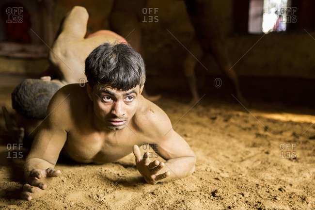 Varanasi, India - March 8, 2014: Kushti wrestler pinned to the ground, Varanasi, India