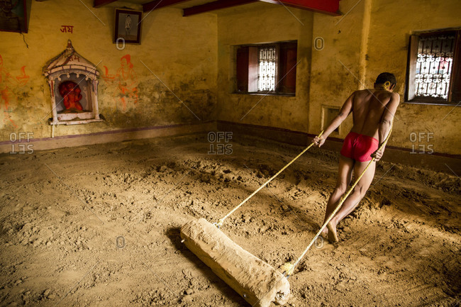 Varanasi, India - March 8, 2014: Kushti wrestler preparing the arena, Varanasi, India