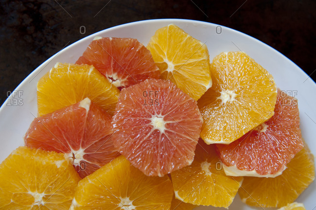 Glistening orange slices on a plate