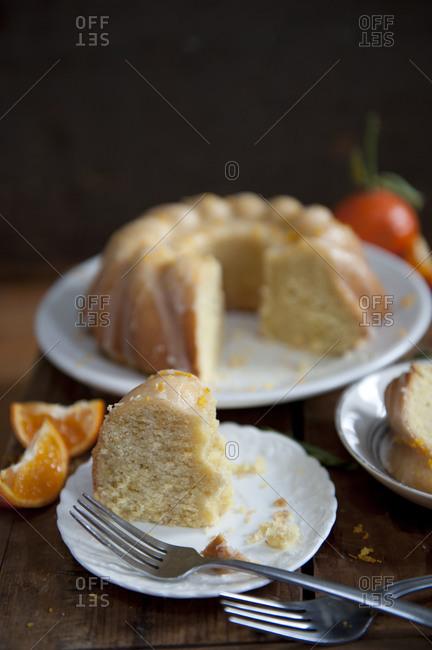 Sliced orange Bundt cake with citrus glaze