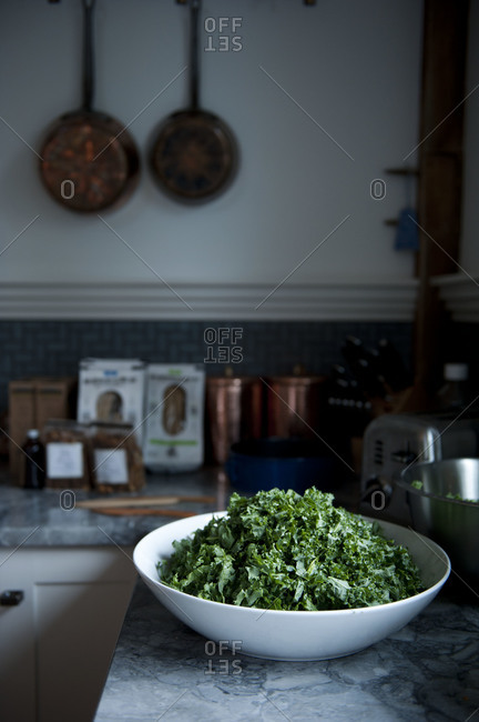 Kale salad in a bowl on kitchen counter