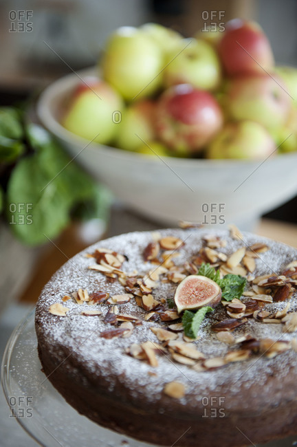 Chocolate cake topped with almonds, mint and figs