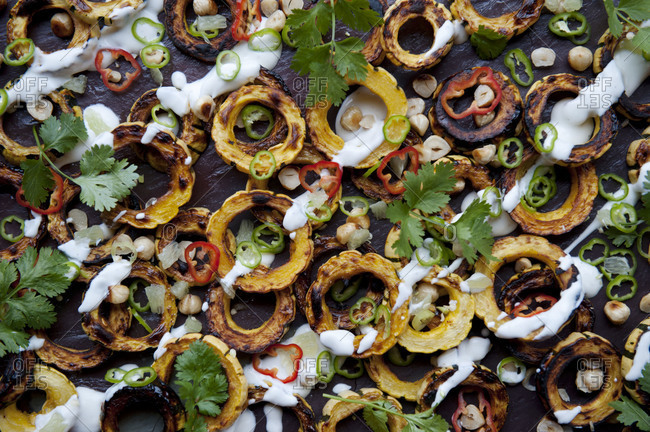 Roasted delicata squash rings  appetizer with peppers and cilantro