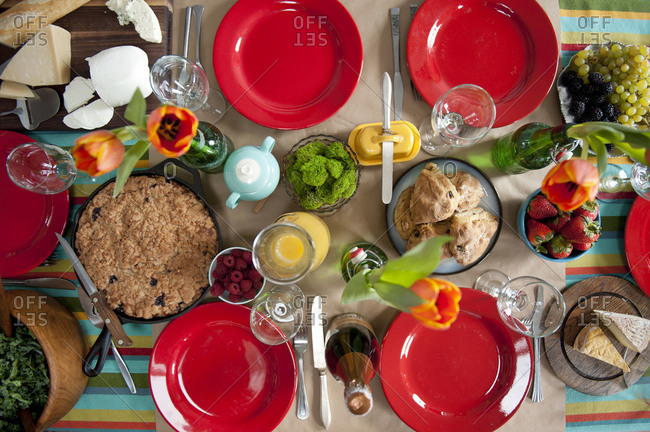 Overhead view of a table set for brunch with a variety of food