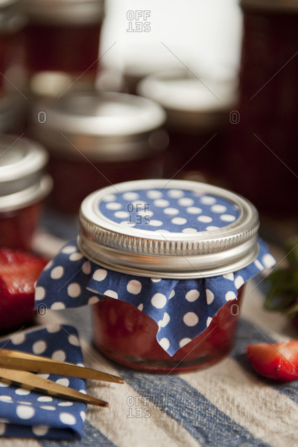 Jars of strawberry jam with fabric cover