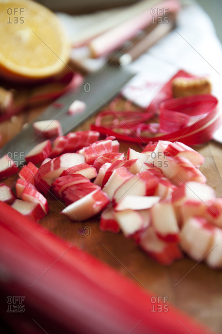 Chopped rhubarb on wooden cutting board