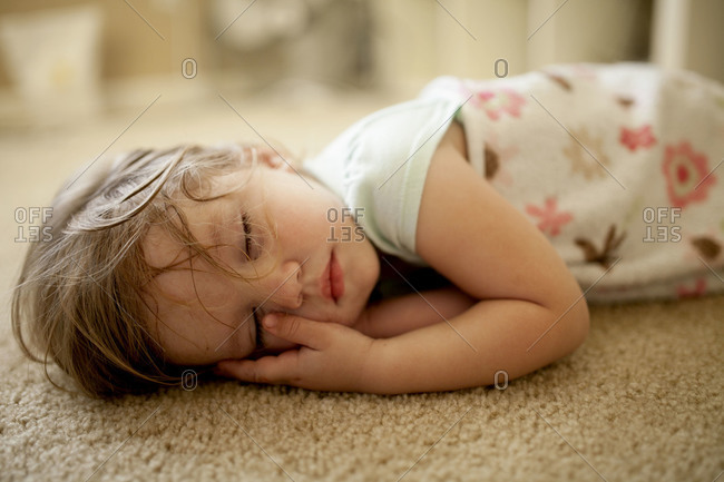 A girl naps on the floor