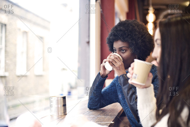 Friends drinking coffee in a cafe