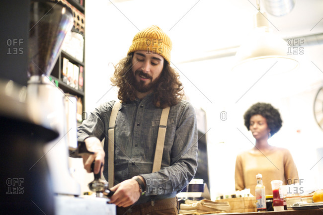 Barista preparing a coffee for a customer