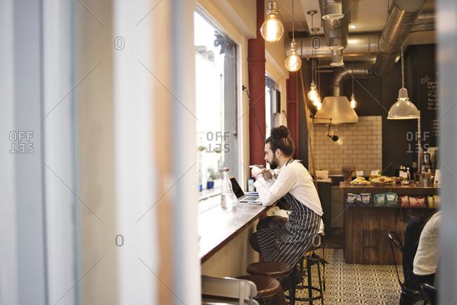 Barista drinking coffee in a coffee shop