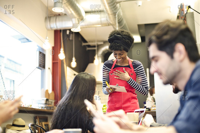 Waitress taking order in a cafe