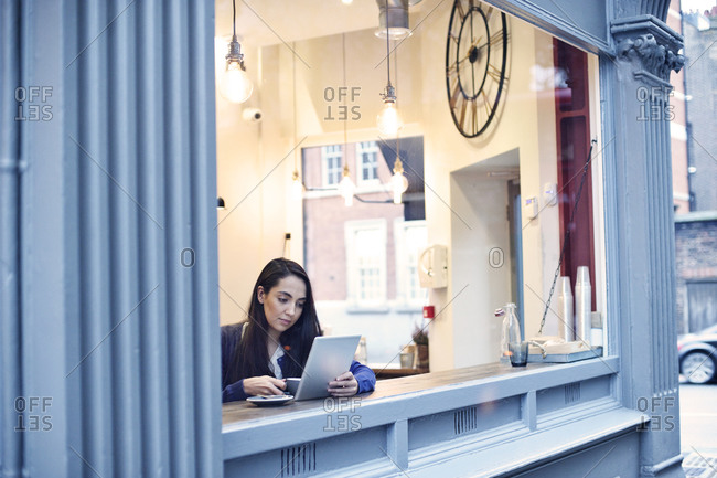 Young woman looking at a tablet in a cafe