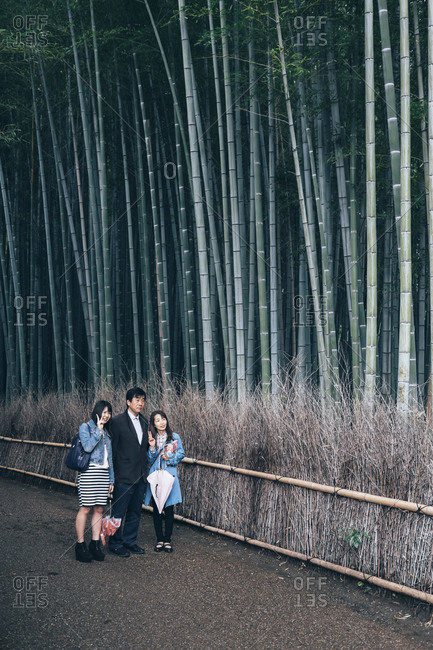 Kyoto, Japan - March 30, 2014: People walking in Kyoto bamboo forest