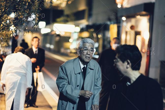 Kyoto, Japan - March 30, 2014: Elderly gentleman walking