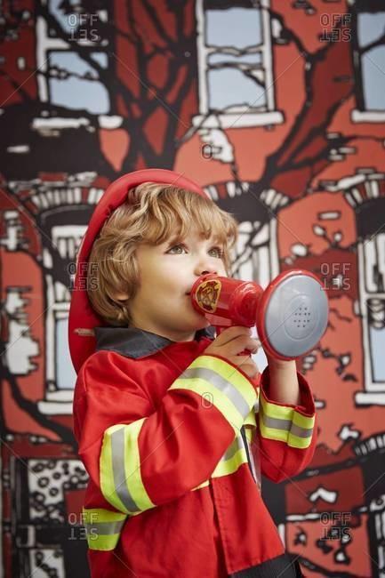 Portrait of boy in fireman outfit