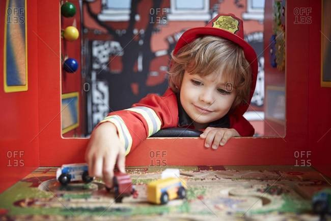 Boy in fireman costume playing