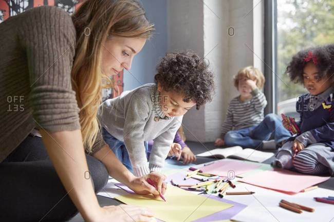 Kids drawing with teacher