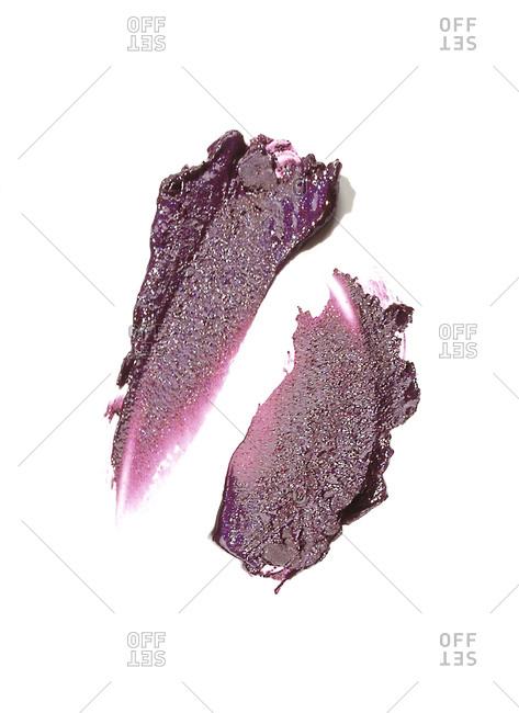 Deep purple lipstick smudges