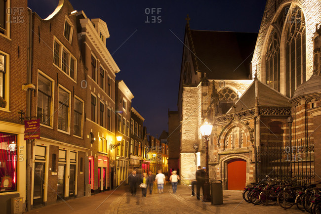 View to Oude Kerk and red light district at evening twilight, Amsterdam