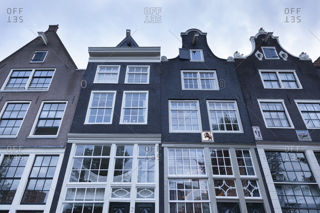 Amsterdam, Netherlands - November 13, 2014: Four facades with divided light windows of residential houses