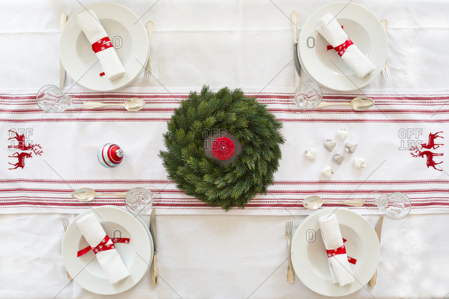 Red-white laid table with Advent wreath at Christmas time