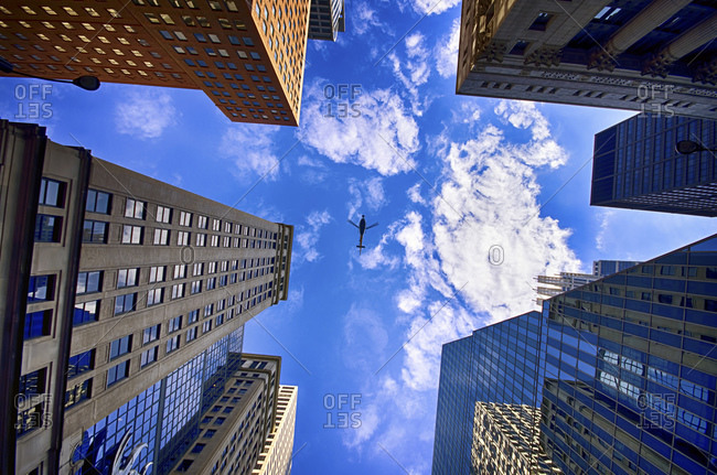 Chicago, USA - November 14, 2014: View to facades of skyscrapers and low flying helicopter from below