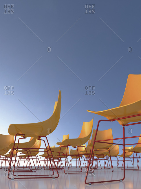 Chairs in front of blue sky, 3D Rendering