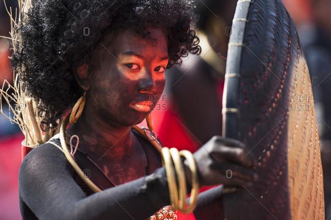 Cebu, Philippines - January 20, 2013: Sinulog street dancer dressed as a native Aeta indigenous person in Cebu, Philippines
