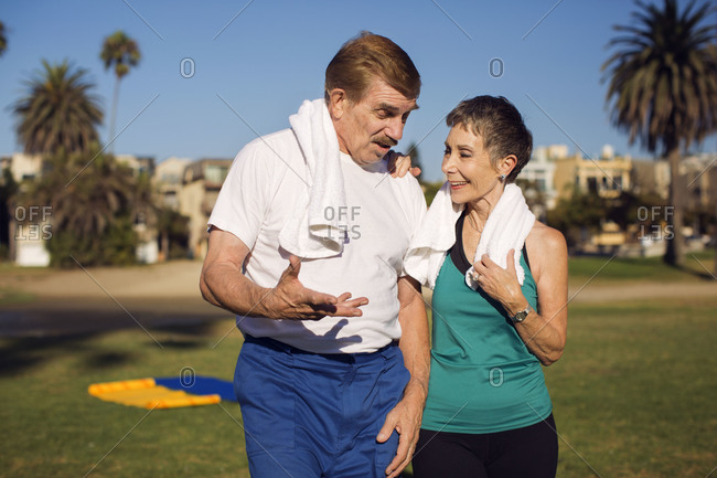An older couple talks during their workout