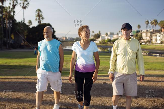 Three older people take a walk