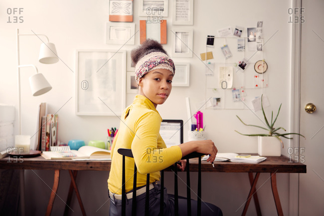 Woman looking back at home work space
