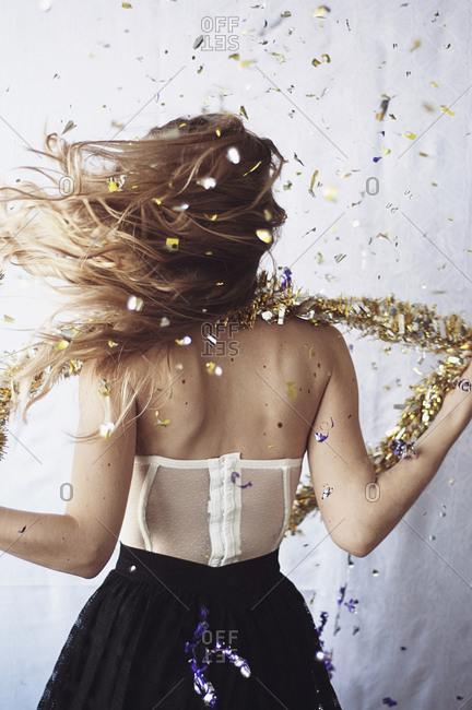 Rear view of girl showered in confetti