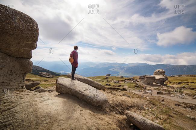 Woman on boulder in Carpathian Mountains
