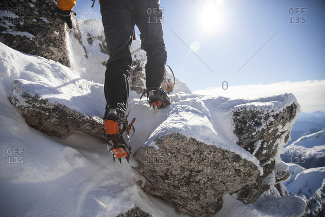 Detail shot of mountain boots with crampons during a climb in the Coquihalla Recreation Area of British Columbia, Canada
