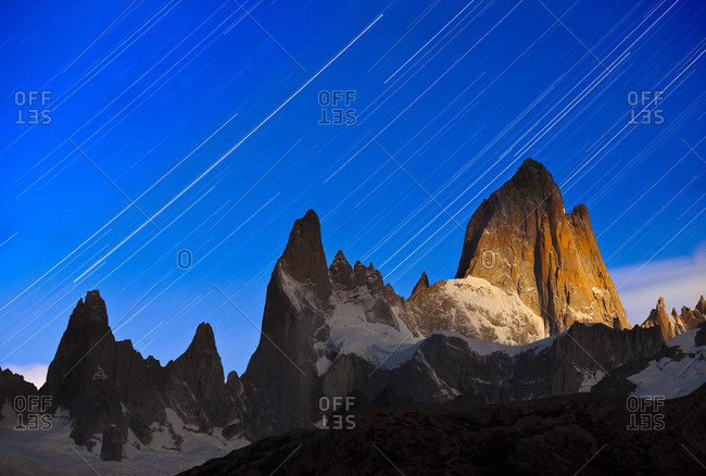 Star trails above a moonlit Mount Fitzroy in Argentina's Los Glaciers National Park