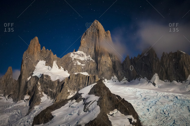 Moonlit Mount Fitzroy from the summit of Cerro Madsen in Argentina's Los Glaciers National Park