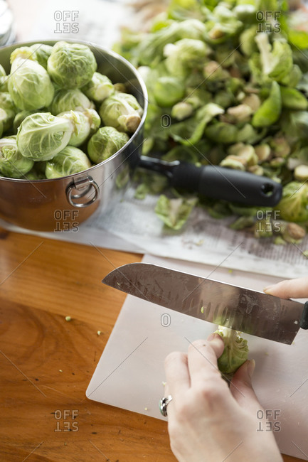 Cook slicing Brussels sprouts