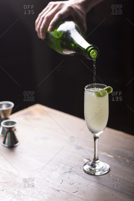 Pouring a champagne cocktail