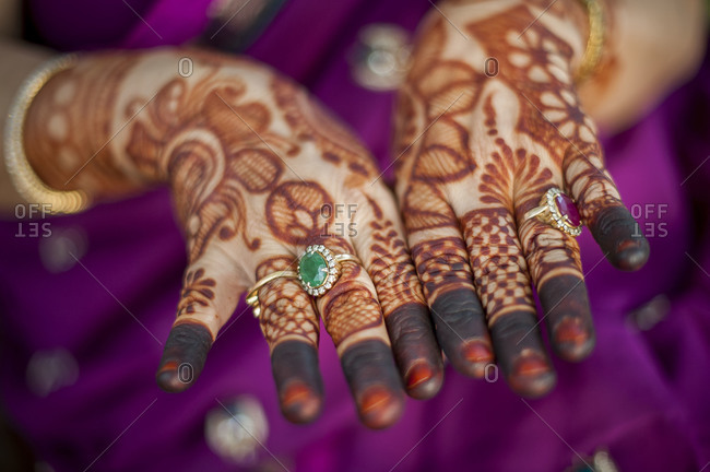 Woman showing her henna tattoos on her hands