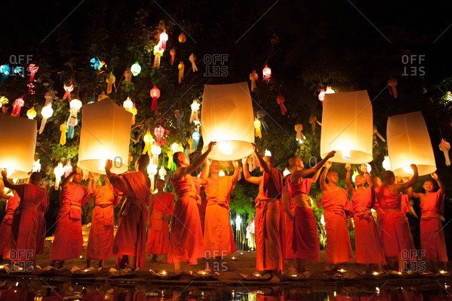 Chiang Mai, Thailand - June 11, 2014: Buddhist monks releasing sky lanterns on a lantern festival