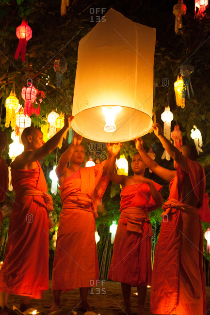 Chiang Mai, Thailand - June 11, 2014: Buddhist monks releasing a sky lantern at the annual lantern festival
