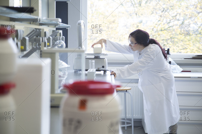 Young female scientist working in a biochemistry laboratory