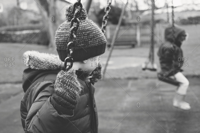 A boy swings in a playground