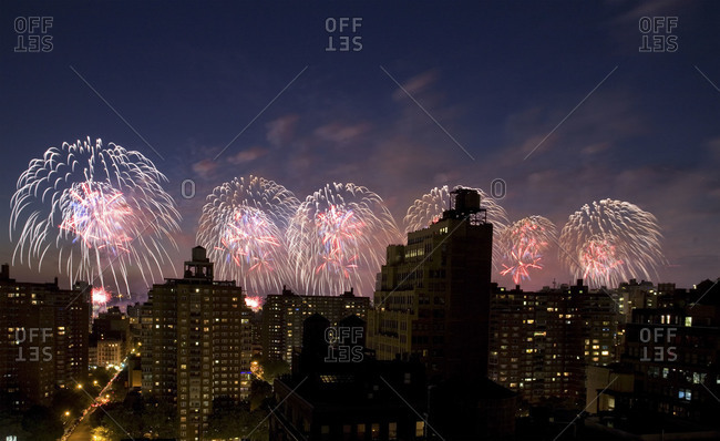 Fireworks explode over a city