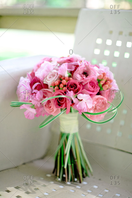 Bouquet of roses on metal chair