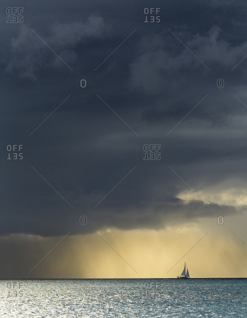 Boat sailing through a rainstorm