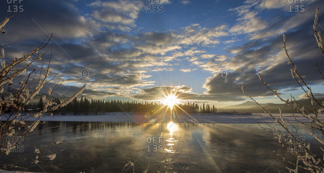 Sunrise over a lake in winter