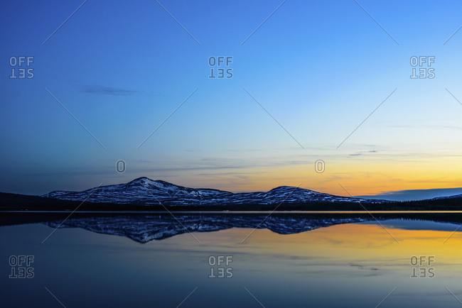 Scenic sunset reflecting in water